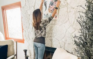 Annette White Hanging her Paint by Numbers