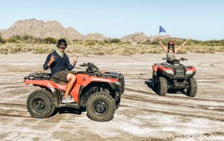 Annette and Peter riding an ATV