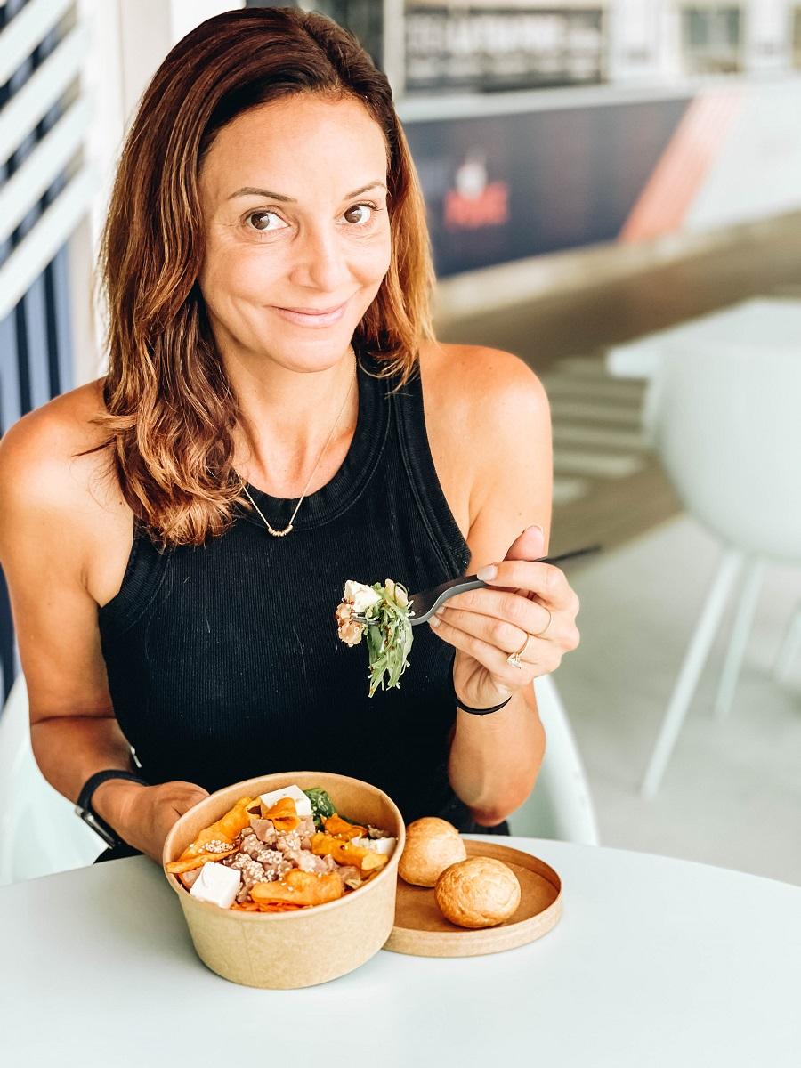 Annette eating a poke bowl